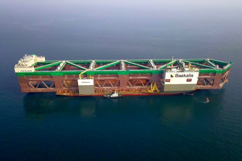 Giant fish farm transported by semi-submersible